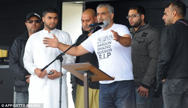 Famous words: After the three men died Tarmiq Jahan (at the microphone), gave an impassioned speech in Summerfield Park, Birmingham, asking for the violence to stop