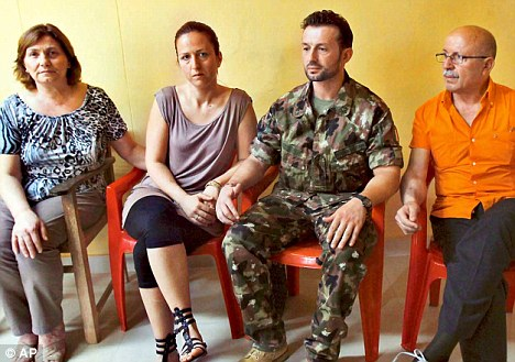 Jailed Italian marine Salvatore Girone (second from right) meets his wife (to his left) and parents in the Thiruvananthapuram central prison on Friday