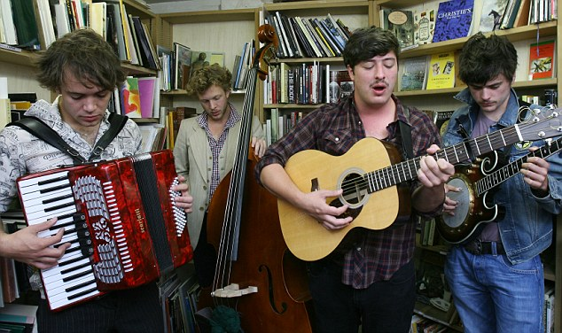 Harmony: Marcus Mumford, centre right, is the lead singer for the band Mumford & Sons, with band mates, left to right, Ben Lovett, Ted Dwane, and Country Winston