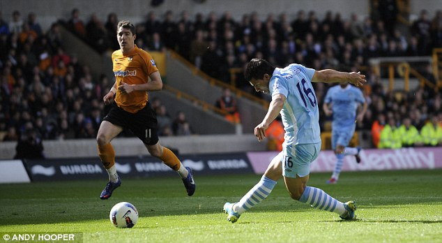 Opening salvo: Ageuro slots the ball home as City go in front against struggling Wolves