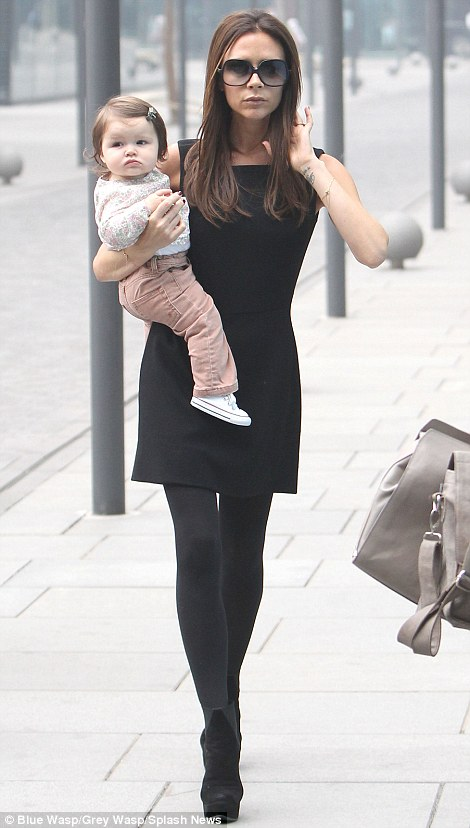 Always time for a bit of shopping: After completing her Rover duties, Victoria brought her daughter Harper to the shops on Monday morning