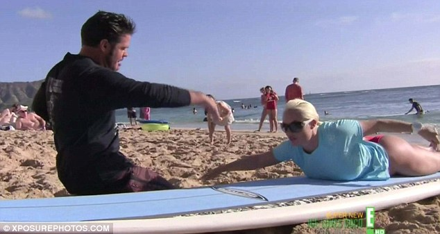 Model student: Before her foray into the surf, the bubbly blonde got a lesson on the sand