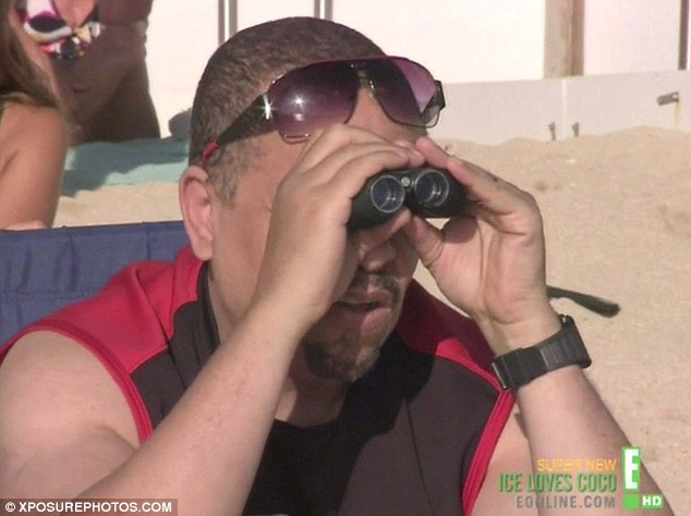Zooming in: However he kept a close eye on Coco by watching her surf through binoculars