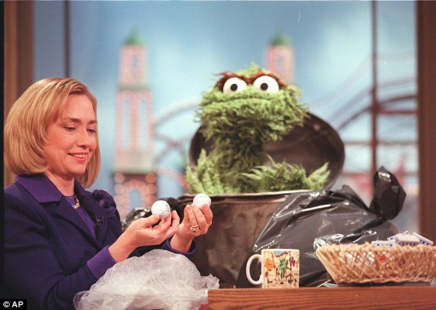 Sesame Street puppet, Oscar the grouch keeps his eyes on first lady Hillary Rodham Clinton in 1997