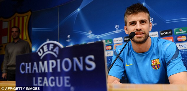 Pep talk: Gerard Pique speaks to reporters ahead of Barcelona's Champions League clash with Chelsea