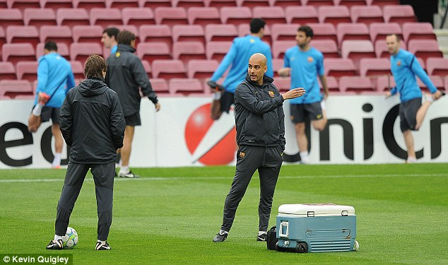 Final preparations: Guardiola has been handing his team their instructions