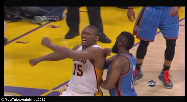 Attack: Metta World Peace threw his left elbow right over Harden's shoulder and into the back of his head after pummeling his chest to celebrate his dunk