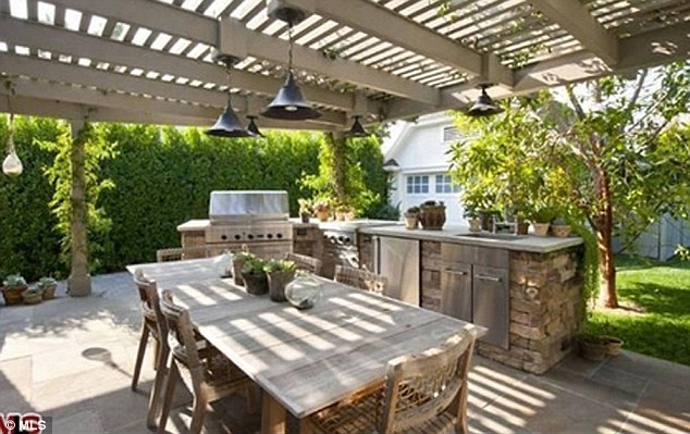 Outdoor dining: The brunette beauty can host a garden party or BBQ here