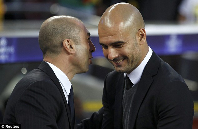 Calm before the storm: Chelsea boss Roberto Di Matteo (left) chats to Barcelona manager Pep Guardiola