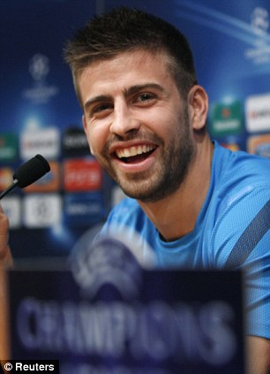 All smiles: Pique was in good spirits on Monday