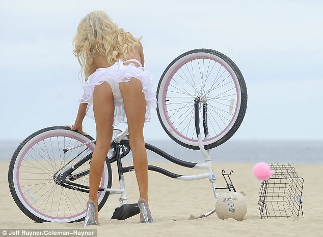 Showing off her skills: Fortunately Courtney knew just how to mend the bike