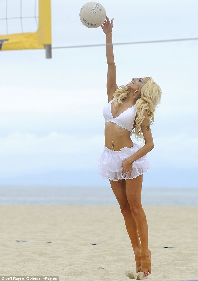 Fun in the sun: Courtney stripped down to her skimpy white outfit before getting stuck into her sports game