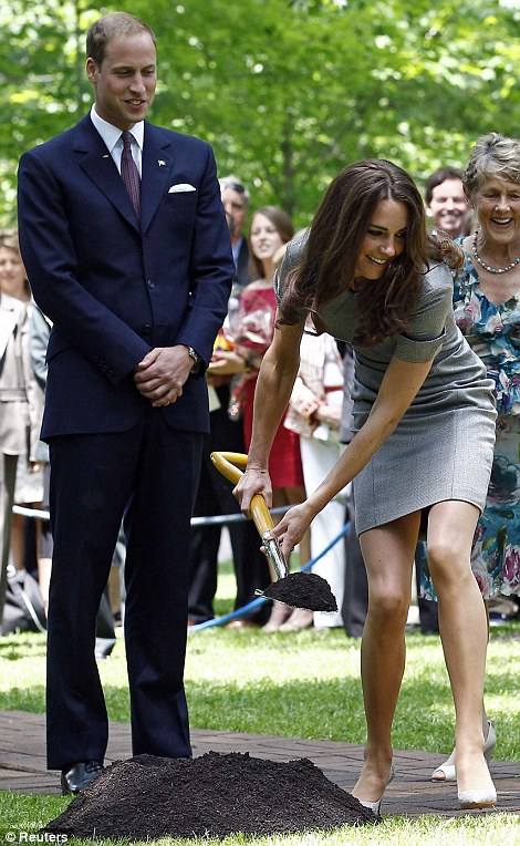 William watches as his wife shovels dirt during a tree planting ceremony at Rideau Hall in Ottawa