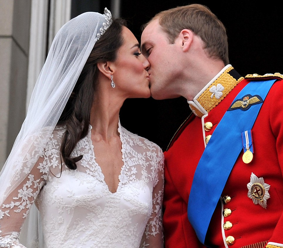 Prince William and Kate Middleton, given the title of The Duchess of Cambridge, kiss on the balcony of Buckingham Palace, London, following their wedding at Westminster Abbey
