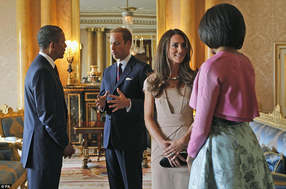April 22, 2012: William and Kate meet with Barack Obama (left) and First Lady Michelle Obama (right), on the first day of President Obama's three-day state visit to the UK - shortly after this photograph appeared Kate's  £175 Reiss dress sold out