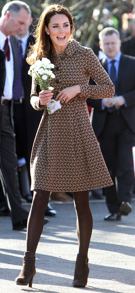 William is still in the Falklands - but Kate is not letting the grass grow underneath her feet. On February 22 she pays a visit to an Oxfordshire school where she takes place in an art class - and gets red paint on her Orla Kiely coat-dress
