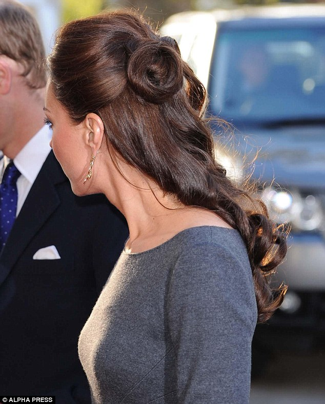 Dazzling: Earlier Kate had worn an indigo tweed Rebecca Taylor suit for her visit to Goldsmiths' Hall