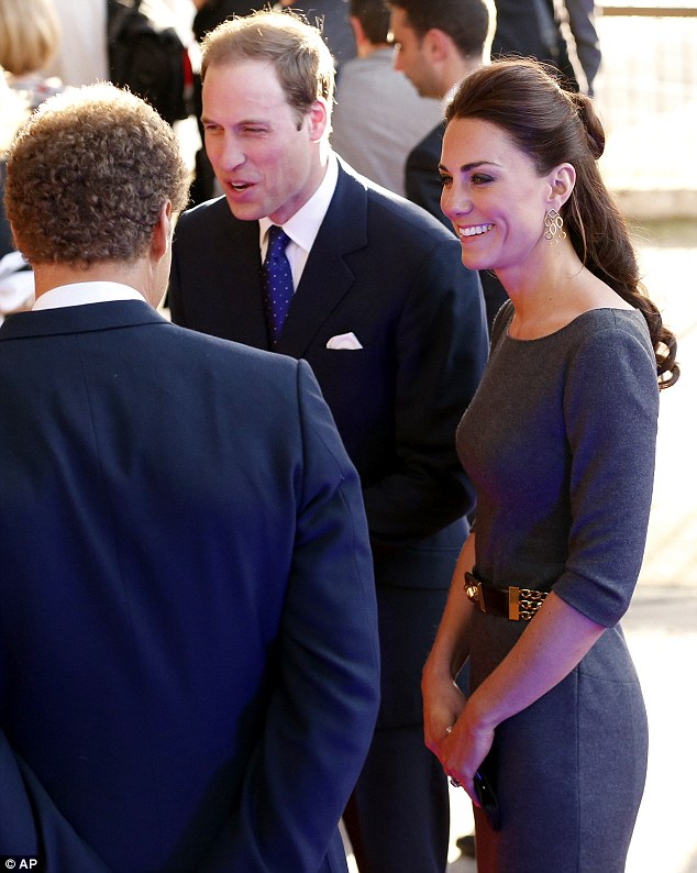 Royal arrival: Kate the Duchess of Cambridge, right, and her husband Prince William, center, are greeted as they arrive for a fund raising reception at the Imperial War Museum in London