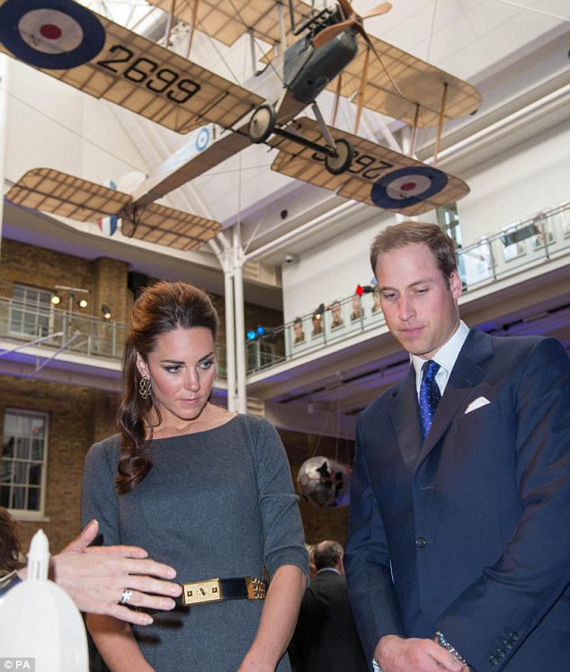 Fundraiser: The Duke and Duchess are shown round the Imperial War Museum in London last night