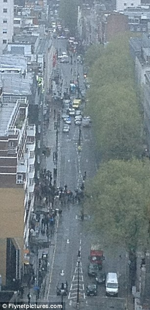 Pictures from the siege at Shropshire House, Tottenham Court Road in London