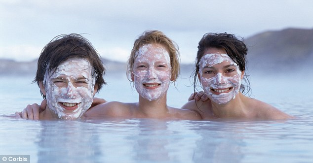Man and two women with mud masks in the Blue Lagoon
