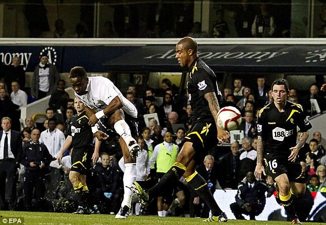 Still fighting: Saha (left) scores against Bolton Wanderers