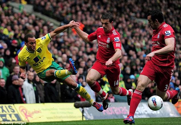 Whipping it in: Elliott Bennett crosses the ball despite the attentions of Jordan Henderson and Jose Enrique