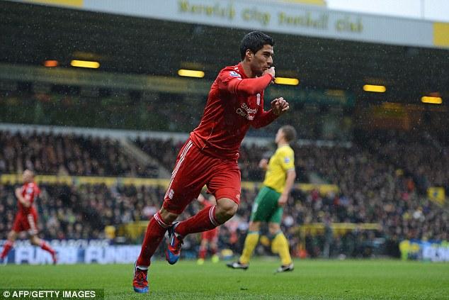 Kiss the ring: Liverpool's Uruguayan striker Luis Suarez celebrates his first