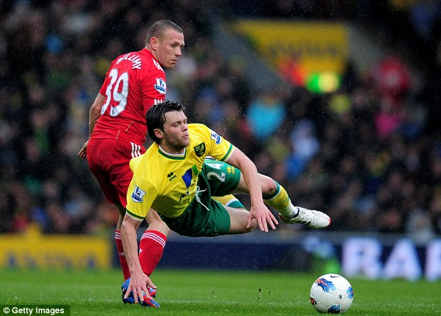 Enjoy the trip: Jonny Howson is brought down by Liverpool's Craig Bellamy