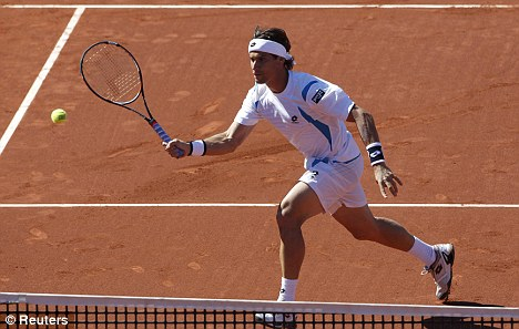 Out of luck: David Ferrer lost yet again to Nadal (below) in Barcelona