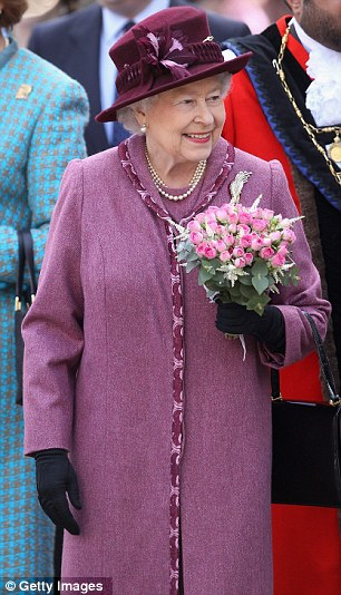 Queen Elizabeth II smiles as she undertakes a walkabout in Windsor today