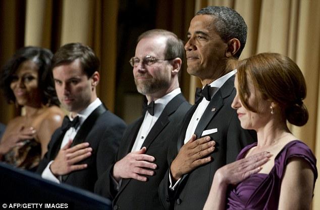 Honoured: President Barack Obama, second left, stands alongside Caren Bohan, right, of Reuters, Reuters Editor-in-Chief Steve Adler, centre, Time's Michael Scherer, and First Lady Michelle Obama, far left