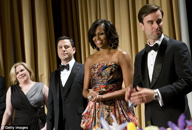 Polished: Mrs Obama arrives to the 2012 White House Correspondents' Association Dinner, where she dazzled in the paisley gown, accessorised with gold hoop earrings and a cocktail ring