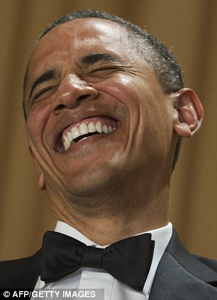 High spirits: Mr Obama was seen throwing his head back in laughter at the dinner table