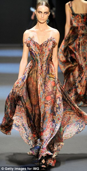 On the catwalk: Models wore modified versions of the gown during the Naeem Khan Fall 2011 fashion show at Mercedes-Benz Fashion Week in New York City