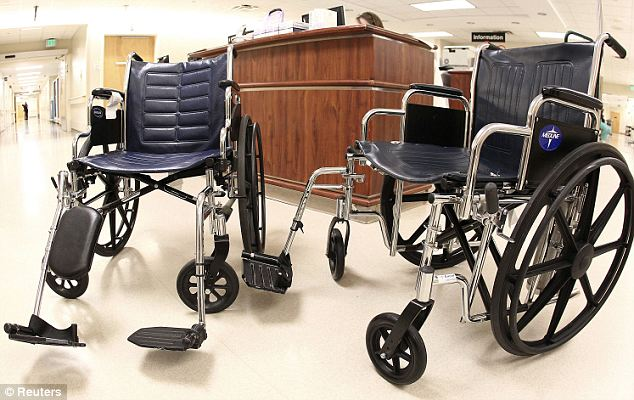 Bigger seating: The University of Alabama Hospital in Birmingham had to order oversized wheel chairs (right) to help obese patients, at approximately double the cost