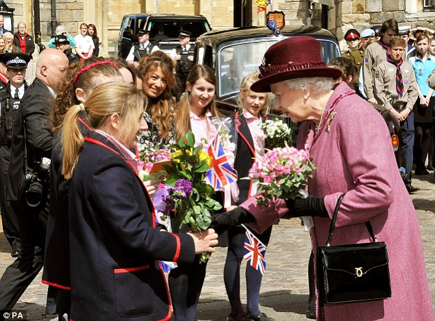 The Queen was handed flowers by local school children during her walk around the town