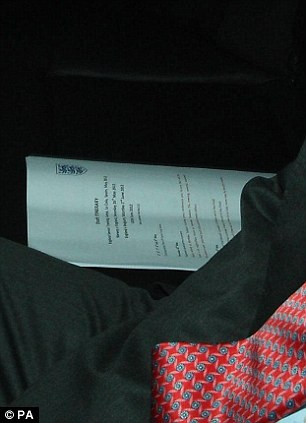 Big plans: The official FA document on England's future lies next to the boss