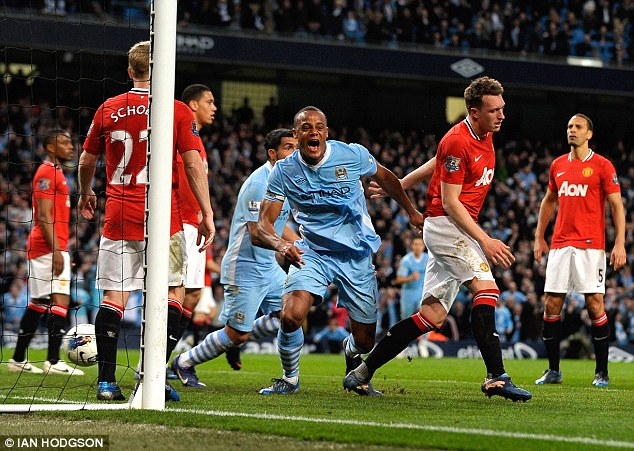 Captain's job: Kompany's header hit the back of the net in time added on at the end of the first half