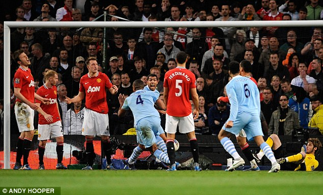 Caught napping: United players look disconsolate after conceding late in the first half