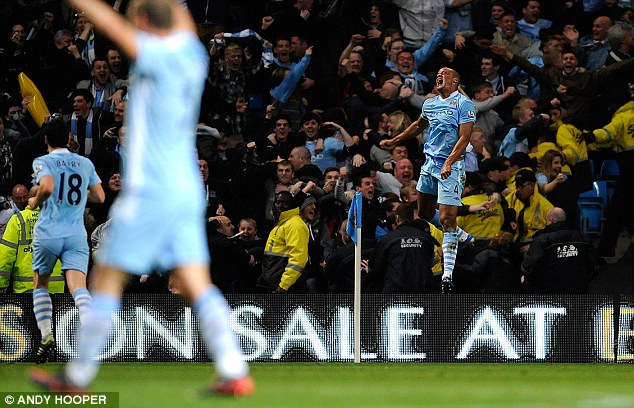 Net result: De Gea is left stranded as Kompany's header slams into the back of the net - enough to make him jump for joy (below)