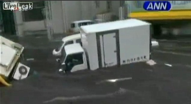 Japan: Footage from the March 11, 2011, tsunami shows a number of similar moving vans being washed along with the tide