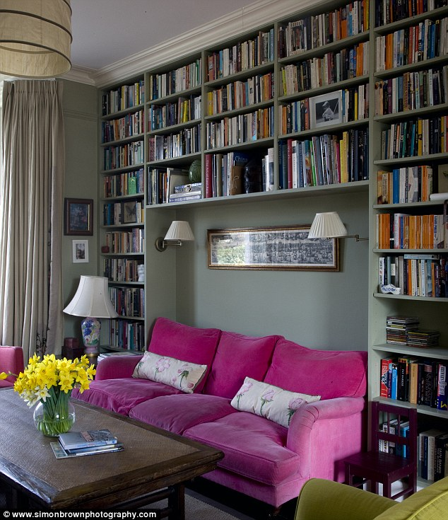 In a room where layout options are limited, create a niche within your shelving for big items such as sofas - that way you don't 'lose' a wall