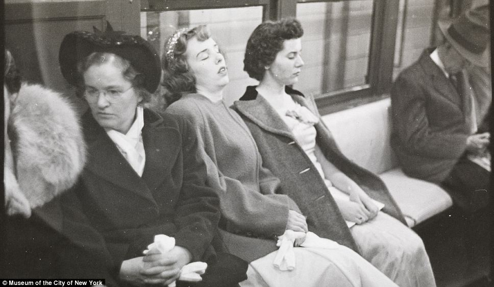 Had enough: Two women catch a quick snooze on the New York subway