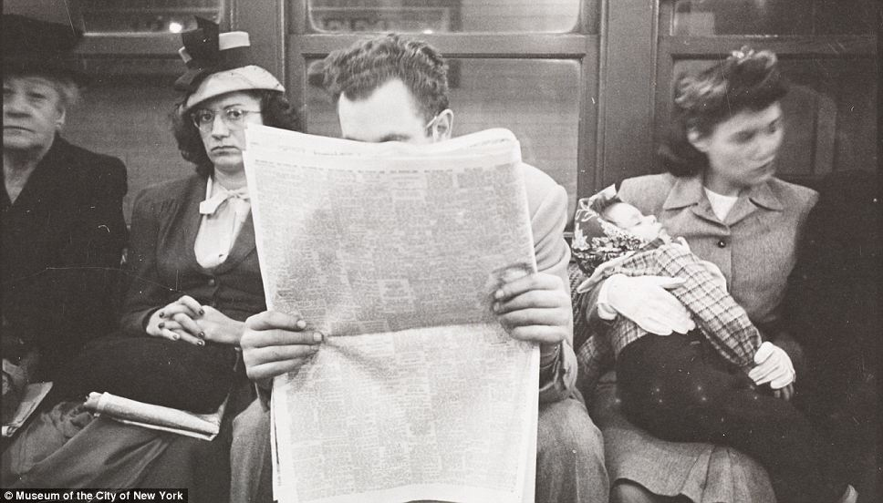 Sly: Another picture shows a woman peering over the shoulder of a man so as to read his newspaper