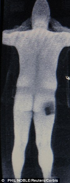 A computer screen shows a scan of a security official in a RapiScan full-body scanner being trialled at Manchester Airport in Manchester, northern England January 7, 2010