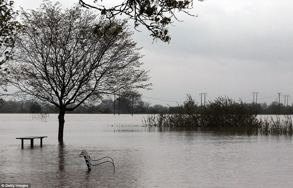 Heavy downpours have caused the the River Severn to burst its banks, leaving large parts of the town of Tewkesbury underwater