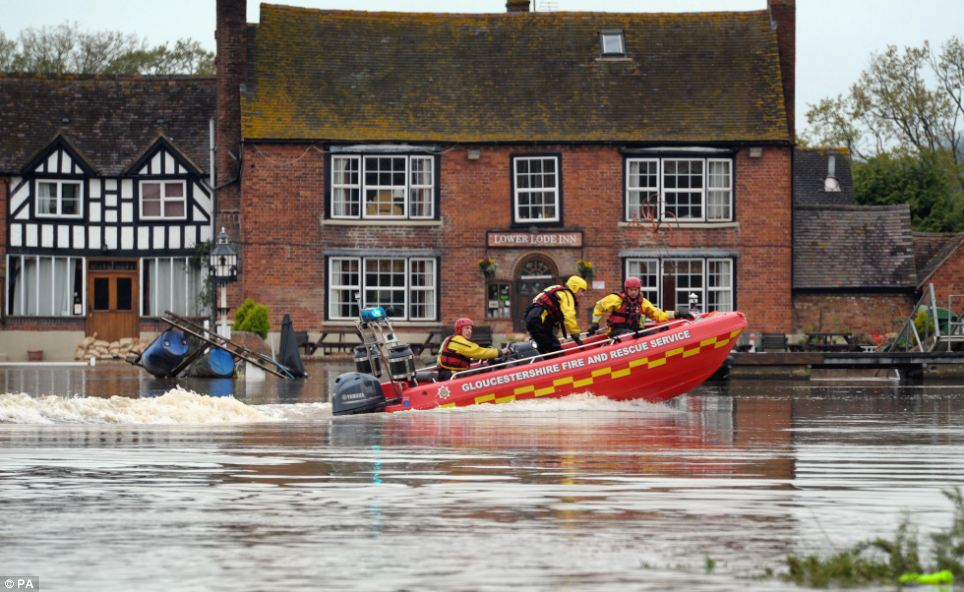 A team from Gloucester Fire and Rescue service scout the flooded areas of Tewkesbury in Gloucestershire after heavy overnight rain