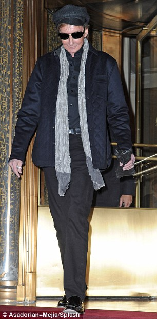 On tour: Manilow was pictured leaving his hotel this week in New York, where he is playing at Radio City Music Hall