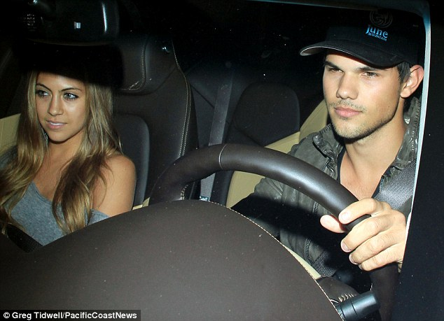 Taylor Lautner takes out high school sweetheart Sara Hicks for dinner at a restaurant in Los Angeles